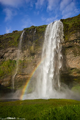 I wish upon every rainbow that I see.. (5PR1NK5 Photography • Off The Beaten Track Urban) Tags: seljalandsfoss foss waterfall falls water iceland landscape rainbow campsite camping wild sun bright bank grass drop sky fluffy clouds nature natral beauty fine art shot rock mountain climb canon photography adventure tour discover seek find experience 5pr1nk5