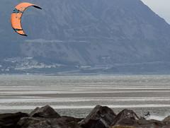 Kite Surfing 5 (Lord Edam) Tags: sea coast coastline beach river sand rocks llandudno conwy clouds waves mountains groyne kite surfing kitesurfing actionsports