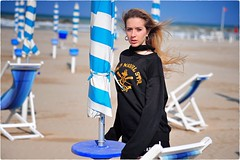 Untitled (Steve Lundqvist) Tags: portrait sweatshirt felpa girl seaside sea mare beach spiaggia nikon 105mm hair beauty women italy adriatic adriatico face young teen teenager shorts sporty sport outdoor sunlight ritratto persone