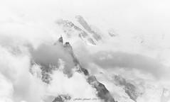 White Storm (Frédéric Fossard) Tags: noiretblanc grain texture glacier montagne aiguilledumidi alpes hautesavoie massifdumontblanc nuage brume orage altitude fondblanc paysage nature art abstrait surréaliste brouillard tourmente