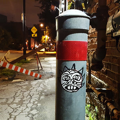 1619B William (Exile on Ontario St) Tags: sticker stickerart griffintown stickers collant autocollant autocollants collants montreal face grimace grin funny character pole street sidewalk roadwork road work streetart urban art urbain night shot nightshot montréal