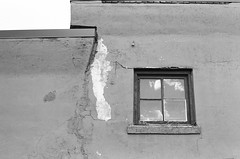 Peeling (Gabby Pike) Tags: window peeling paint old aged weathered building no person cracked brick cinderblock windows bnw monochrome black white kodak tmax 400 canon ae1 film analog analogue photography