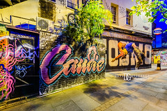 """Jump"" Brick Lane, Shoreditch, London, UK (davidgutierrez.co.uk) Tags: london photography davidgutierrezphotography city art architecture nikond810 nikon urban travel color night blue londonphotographer uk graffiti shoreditch bricklane eastlondon community colour colours colourful arts culture photographer street centrallondon england unitedkingdom colors 伦敦 londyn ロンドン 런던 лондон londres londra europe beautiful cityscape davidgutierrez capital structure britain greatbritain streets d810 artistic streetart artist candid bluehour twilight buildings longexposure le landmark ultrawideangle afsnikkor1424mmf28ged 1424mm lights vibrant road attraction dusk market streaminglights lighttrails shop people person londonboroughoftowerhamlets"