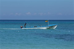 """Don't worry, be happy"" (smilla4) Tags: candid fishermen boat pasta water caribbean sky blue clouds mellow ochorios jamaica"