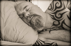 Sleep. (CWhatPhotos) Tags: cwhatphotos olympus four thirds camera sleep sleeping sleeper snooze man photographs photograph pics pictures pic picture image images foto fotos photography artistic that have which contain me self selfie portrait face beard bush bushy full hairy chin goatee sepia mugshot male tattoo tattoos tattooed tribal ink inked shoulder torso chest tatt tatts