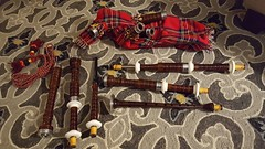 Putting it together (Mamluke) Tags: bagpipe assembly disassembled rug carpet floor instrument music musicalinstrument mamluke home tartan rosewood reed bag pipes pipe langtryhouse langtry