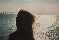 Hair in my mouth (veraernelli) Tags: artsy 35mm 200film fuji mouth wind ginger redhair 2017 1952 öresundsbron öresund sweden denmark bridge sun hair analog contaxiiia contax colorfilm fujifilm filmisnotdead film rangefinder ocean