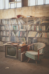 Abandoned home library (No Stone Unturned Photography) Tags: abandoned home house library tv suitcase arizona urbex books