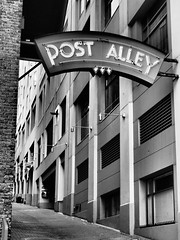 Post Alley (paulhall) Tags: 170709pikeplacemarket blackandwhite mountaineers photographiccommittee pikeplacemarket places postalleygumwall seattle washington waterfront olympustg5 filep7090228