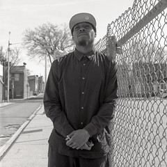 (patrickjoust) Tags: 6x6 medium format 120 tlr twin lens reflex black white bw home develop discontinued expired kodak film blancetnoir blancoynegro schwarzundweiss manual focus analog mechanical patrick joust patrickjoust east baltimore maryland md usa us united states north america estados unidos urban street city man standing fence portrait