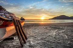 Sunrise in Camboriu Beach (rqserra) Tags: amanhecer alvorecer praia barco céu sol sunrise beach boat sky clouds colorfull rqserra camboriu brazil