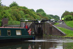 Delph Locks - Dudley Canal, Brierley Hill (PGview) Tags: delphlocks ninelocks barge cyclist fluorescent helmet bicycle flag water bushes path recreation blackcountry stourbridgecanal dudleycanal