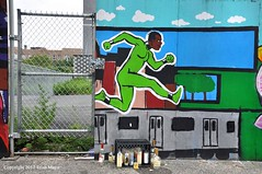 Overcoming All Obstacles (Trish Mayo) Tags: superhero actionhero bronxmural paintedwall fence memorial