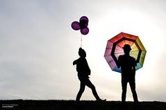 Attitude (disgruntledbaker1) Tags: backlight balloons umbrellas disgruntledbaker