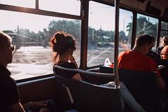chaleur (ewitsoe) Tags: tram passenger canon sigman lens art glass window train transit poznan woman redhead man men sitting ride living commute poland red glow sun warm