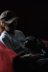 Moment in Time (John Neziol) Tags: jrneziolphotography nikon nikondslr nikoncamera nikond80 schnauzer miniatureschnauzerchihuahuacross brantford pet portrait lowkey dog dognose woman girl nikonflickraward inthedarknessoftheshadowandnight