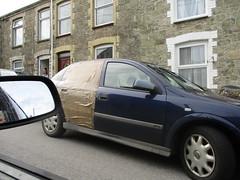 Bangernomics (occama) Tags: vauxhall astra tape old car damaged 2000