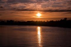 D8686E7 - Bronze Sunset Over Water (Bob f1.4) Tags: sunset over water bronze orange silhouette ripples california sacramento delta clouds fire sky boating scenes