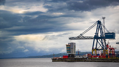 Clydeport at Greenock (Coisroux) Tags: harbour port greenock clyde riverclyde industrial crane engineering prominade industry scotland scotlanddiscovered ominoussky clouds d5500 nikond containers freight esplanade inverclyde dockside
