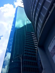Sky view (santoscinderella) Tags: mirrors big lookup up beautiful photography shot iphone view city florida brickell architecture reflection bluesky blue sky clouds blending tall buildings skyscrapers miami