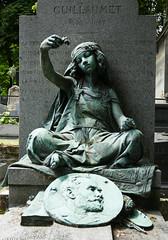 Young woman drops flowers on a grave (Monceau) Tags: cimetièredumontmartre verdigris sculpture young girl northafrican flowers relief image painter