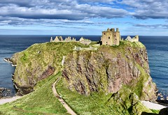 Dunnottar Castle Ruins  15th Century Scottish Highlands 2017 (DanoAberdeen) Tags: dunnottar scottishhistory castleruins amateur candid historicscotland scottishcastle dunnottarcastle aberdeenshire stonehaven danoaberdeen danophotography geotagged countryside scenery landscape history autumn winter summer spring ecosse escocia scotia caledonia highlands scottishhighlands nikon nikkor nikond750 bluesky countrywalk medievalfortress 15thcentury ruins abandoned nationaltrustforscotland castle ruined neglected weathered scotch 2018 recent blue museum northeastscotland schotland knights bonnyscotland 16thcentury golden ancient oldtimer olddays dunnottor scotland bonnie medieval landmark maryqueenofscots earlmarischal geotag geaotagged fortress outdoors preservation conservation visitscotland hiddenscotland northeast photoshop