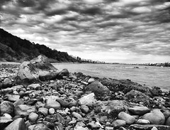 Movement in the sky (Mario Ottaviani Photography) Tags: sony sonyalpha italy italia paesaggio landscape travel adventure nature scenic exploration view vista breathtaking tranquil tranquility serene serenity calm marioottaviani movement sky cloudscape clouds nuvole movimento cielo blackandwhite blackwhite biancoenero monocromatico monocromo monochrome sea mare shoreline shore stones sassi