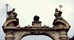 2010-08-05ab Guardians ([Ananabanana]) Tags: nikon d40 gimp photoscape 1855mm 1855 nikkor nikon1855mmkitlens nikon1855mm nikonafsdx1855mm nikkor1855mm nikkorafsdx1855mm nikonistas nikonista lviv lvov lemberg lemburg ukraine ukrainian arch archway door doorway church cathedral stgeorge styuriy dragon catholic greekcatholic russianorthodox mary paul