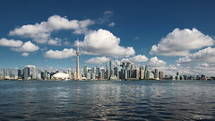 Toronto Skyline (Ontario, Canada) (Andrea Moscato) Tags: andreamoscato canada america view vista vivid sky skyscraper skyline cielo clouds city città cityscape nature natura nuvole town downtown buildings blue white water freshwater acqua lago lake line light luce reflection riflesso shadow ombre waves