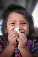 Young Girl with Money (mayanfamilies) Tags: guatemala mayanfamilies tierralinda vitaminangels children distribution malnutrition vitamins wellness fundaciónfamiliamaya mayan families charity donate canon eos 5d