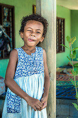 Cheeky Princess -1 (Steve McGrady) Tags: red cheeky younggirl fiji fijian islander bluedress green