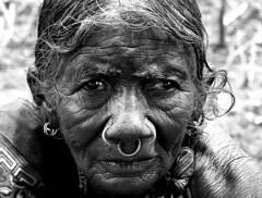 Faces of India- portrait of a lady from Araku Valley, India (senguptapulak) Tags: portrait black white elder lady wrinkles face ornament macro lens natural light canon 100mm f28