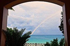 After the Showers (The Spirit of the World) Tags: rainbow ferns tropical sea ocean indianocean seascape waterscape doorway nature zanzibar tanzania africa tain rainyseason