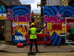 Surveyor (Steve Taylor (Photography)) Tags: haka constructionsite hardhat spotify know danger deepexcavation patterson digger art graffiti mural streetart sign building construction door colourful man men uk england london