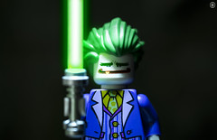 Joker Found a Lightsaber (jezbags) Tags: lego legos toys toy minifigure minifigures macro macrophotography macrodreams macrolego canon60d canon 60d 100mm closeup upclose dc dclego legodc joker lightsaber green saber starwars