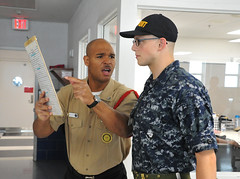 A recruit division commander explains the importance of deck-log accuracy and legibility to a recruit. (Official U.S. Navy Imagery) Tags: recruit training command bootcamp rtc greatlakes ill unitedstates usa