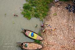 """Untitled"" (jamiul_adnan) Tags: boats umbrella river bathing kids men utensils working daily life bangladesh summer flickrtravelaward ★excellent★"