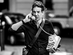 Street - Old-style phoning ! (François Escriva) Tags: street streetphotography black white bw noir blanc nb man olympus omd phone phoning talking photo rue funny fun candid