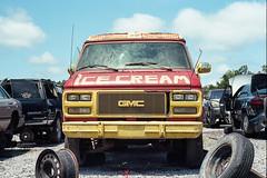 Ice cream truck (ADMurr) Tags: dab081 ms ice cream truck red yellow clouds sky tire wheel junk yard leica 6 summicron