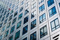 HSBC In Reflection (Sean Batten) Tags: london england unitedkingdom gb canarywharf docklands eastlondon architecture pattern building reflection lines windows city urban nikon df 58mm blue hsbc sky clouds onecanadasquare