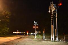 Train coming! (antennawizard) Tags: train railroad cn csx grade crossing signal sign night rockford il illinois freeport buckbee milepost8355west control point gates