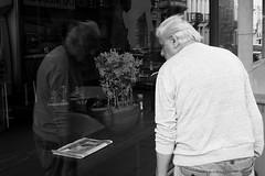 Who Are You ? (Ren-s) Tags: blackandwhite black blanc blackwhite nb bnw bw noiretblanc noir noirblanc street streetphotography rue photographiederue man homme people personne guy old vieux reflection reflet vitre glass window fenêtre journal paper newspaper fleurs flowers flora new olympus bruxelles brussels belgique belgian belgium belge europe european sweater pullover cheveux hair gris looking regard mouvement movement urbain urban summer été city ville downtown town centre nouveau soir contrast contraste life vie cityscape