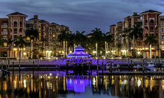 Night Time on Naples Bay (C. P. Ewing) Tags: sky sunset sundown architectecture lights bay water gulf ocean reflection colors colorful night nightfall nightime palms tree trees nature outdoor outdoors boat boats building buildings cloud clouds blue red pink gold golden car cars landscape landscapes panorama