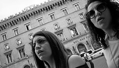 Who me!! (Baz 120) Tags: candid candidstreet candidportrait city candidface candidphotography contrast street streetphoto streetcandid streetphotography streetphotograph streetportrait rome roma romepeople romestreets romecandid europe monochrome monotone mono blackandwhite bw noiretblanc urban voigtlandercolorskopar21mmf40 voightlander leicam8 leica life primelens portrait people unposed italy italia girl grittystreetphotography faces decisivemoment strangers women