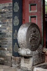 CENTURIES OF WEAR ON THESE CARVED GRANITE WHEELS AND STAIR WAY AT THE ENTRANCE OF THE GREAT MOSQUE, XI'AM, CHINA. (vermillion$baby) Tags: greatmosque xiam great mosque ancient banister china door round sphere stair stairpath xian grandmosque old spring xiansgreatmosque