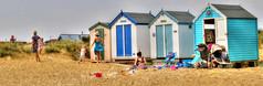 beach life (robin denton) Tags: beachlife beach beachhuts beachhut seaside hdr photomatix southwold suffolk people peoplesitting peopleseated sitting seated play sit