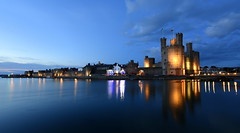 Hot Summer Knights (Peter.S.Roberts) Tags: interestingness interesting caernarfon northwales caernarfoncastle 531393°n42769°w hotsummerknights longexposure summer evening landscape seascape bluehour night water river castlewalls riverseiont houses dwellings pub turrets flags lights lighting illumination reflections boats boating harbour harbor reflectionsonwater clouds blue bluesky quiet peaceful tranquil serene perspective 2227pm nightscape pov dof riverscene scenic colours colourful calm placid relaxing coast coastal explore flickriver fluidr