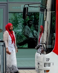 Self reflection (A. Yousuf Kurniawan) Tags: people red contrast woman hijab streetphotography streetphoto streetlife urbanlife urban moslem colourstreetphotography colourful reflection bus beautiful dailylife juxtaposition