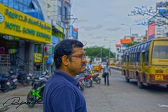 Street watch (Rajavelu1) Tags: streetphotography street candidstreetphotography candidportraitphotography canon60d colours blue green bus bikes