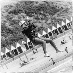 Zip Wire Thrills (ArtfulAl) Tags: people action nikon d300 zipwire bournemouth beach niksilverefexpro2 mono blackandwhite square